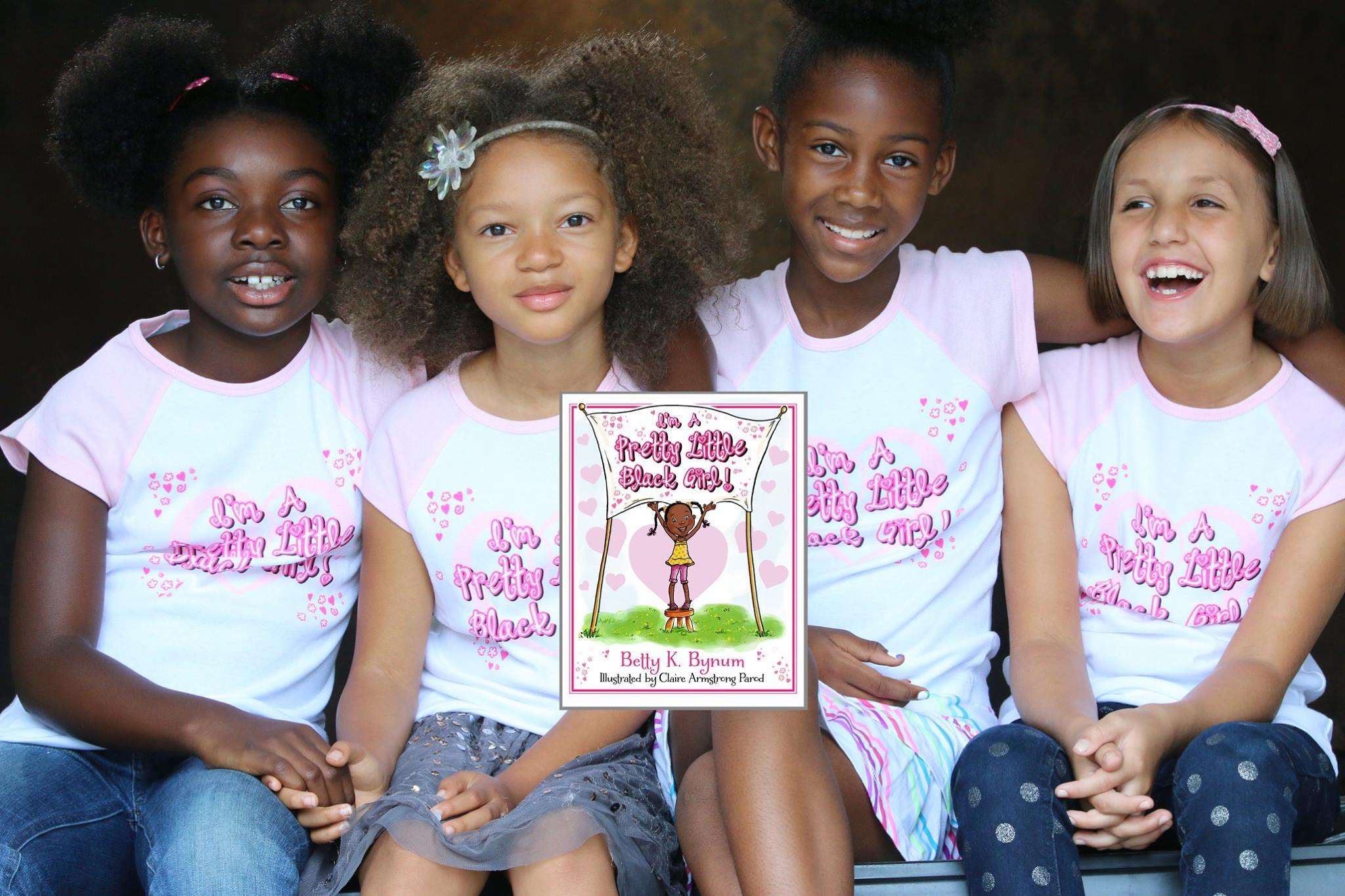 ALL GIRLS WITH BOOK IMAGE KMH WEBSITE IMAGE 10955081_916654941713219_3162246373031888549_o